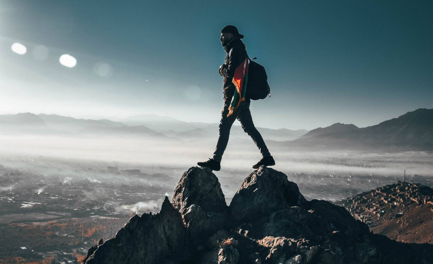 person-standing-on-top-of-rock-1576937 (1)